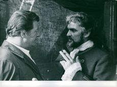 """Sir William Stanley Baker talking to man in a scene from the movie, """"Where's Jack?""""."""