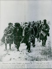 Soldiers marching together. 1966