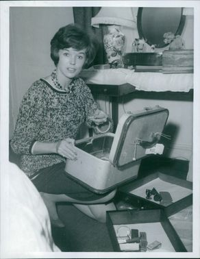 Dawn Addams at home with the ransacked cases after burglar stole her jewellery.