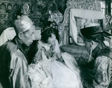 Hope Cooke holding a fabric and having a conversation inside the royal house of Sikkim.