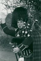 Bagpipe player Justen Karlsson.