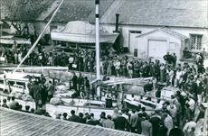 People gathered at the harbor for the expedition of Alain Bombard, 1965.
