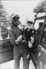 King Carl Gustaf on his way to carrying a little 8 months Madeleine in the car under a heavy snow