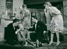 """The devastated Agneta Prytz flanked by Frank Sundström and Tom Dan-Bergman with Harriette Garellick in the background, in """"My wife goes again"""""""