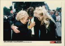 Jimmy Connors comforts Vitas mother and sister at Vitas Gerulait's burial on Long Island