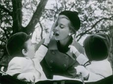 Geneviève Page playing with her two children. 1963.