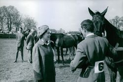 Queen Elizabeth II talking to a horse rider, 1968.