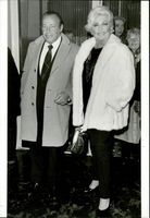 Git Gay standing with her husband, Lennart Carp in the event.