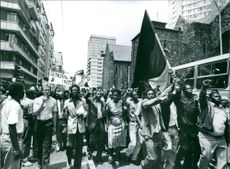 Funeral protest in Johannesburg: Black South Africans mourn Dr. Neil Aggett, 1982.