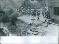 A photo of protesting people damaging properties of Lebanon during its Civil war.