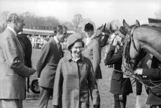 Princess Anne smiling, at race course.
