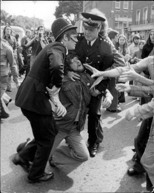 The policemen are making an intervention at the demonstrations in Hackney, East London.