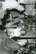 Director Gilbert Lewis with Roger Moore and his wife Luisa at Regine's Paris Boite
