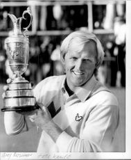 Golf player Greg Norman with the trophy after the win in the British Open 1986