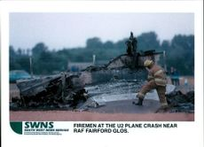 Aircraft crash:fire men at the u2 spy plane.