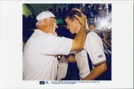 Stefan Edberg is hugged by his coach Tony Picard.