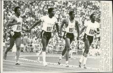 Americans Eddie Hart, Larry Black, Robert Taylor and Gerald Tinker run around the track after taking gold at 4x100m during the 1972 Olympics