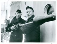 """Two of the crew members who are with the destroyer """"Halland"""" last trip of the year."""