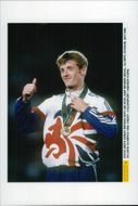 British high jump jumper Steve Smith with his bronze medal at the awards ceremony during the Olympic Games in Atlanta in 1996