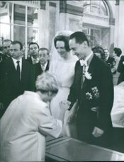 Carlos Hugo shaking hand with woman, Princess Irene standing beside during their wedding. 1964