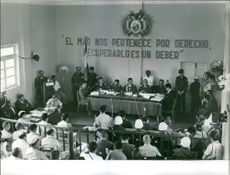 Soldiers and people in a hall during the trial of Regis Debray.