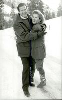 Roger Moore embraces his wife Luisa near their home in Gstaad