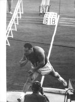 An athlete in a competition, 1964.
