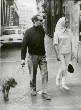 Actress Sarah Churchill walks on Via del Corso with Lobo Nocho