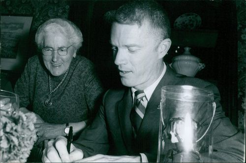 Rusty Schweickart, with an old woman, smiling,