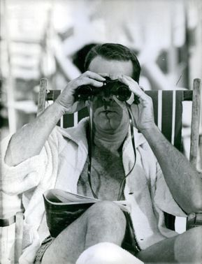 Fred MacMurray photographed looking through the binoculars. 1961.