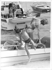 Brigitte Bardot`s son jumping into the sea.