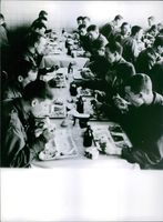 Soldiers having their meal, during war in France, 1963.