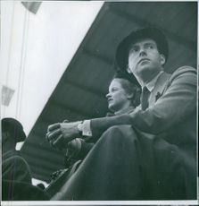 A couple sitting and watching an event. 1939