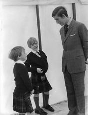 Charles, Prince talking with a small children.