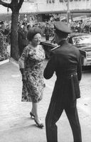 Queen Juliana smiling at an officer.