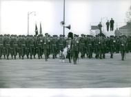 Military people welcoming Prince Philip and Elizabeth II's arrival.