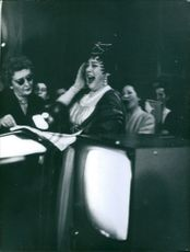 A photo of an Italian lirico-spinto soprano popular in the post-war period Renata Tebaldi singing with women, 1960.