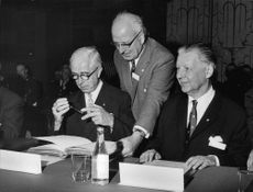 Two prominent congress participants, dir. D. Helsing and G. von Haartman write their name in an autograph during the International Skål Congress