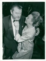 Jack Hawkins with his wife on a premiere