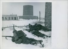 Soldiers firing during wartime.