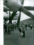 1961 Bourget  People gathered on the Le Bourget Airport runway to watch an air show.