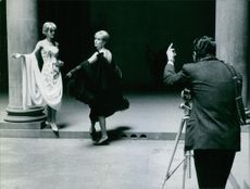 Photo shooting of two women wearing Emilio Schuberth's designed dress.