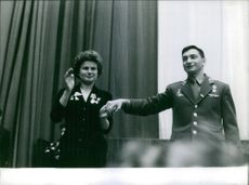 Valentina Tereshkoba holding hands with a military guy.