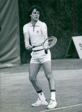 Uri Pinner playing tennis.
