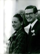 Princess Margriet of the Netherlands and her husband Pieter van Vollenhoven are looking at somewhere and smiling