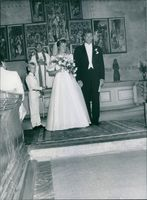 Wrestler, Frank Andersson with his wife in church during their wedding day.