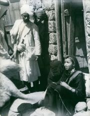 Native people sitting in front of house in Yemen.