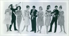 Musician models posing and being photographed, 1962.