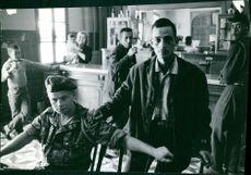 Soldiers and people inside a bar in Algeria.