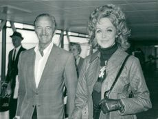 Actor David Niven arrives at London Heathrow together with his wife Hjördis